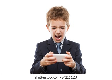 Little handsome smiling child boy in business suit playing games or surfing internet on digital smartphone computer white isolated