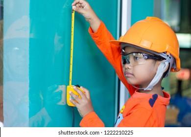 little handyman boy asian