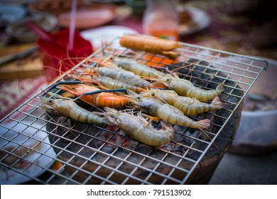 Little happiness inside family with main menu is grilled shrimp.