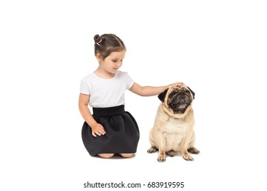 little happy adorable girl with pug dog, isolated on white