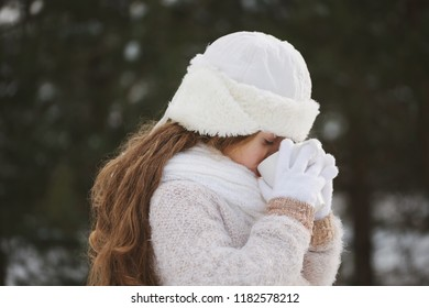 little happy beautiful girl in winter forest