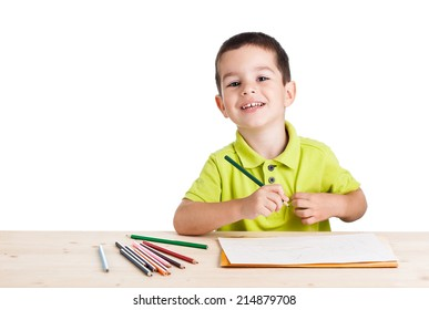 Little happy boy drawing with colorful pencils, isolated on white background