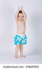 little happy boy with swimming suit