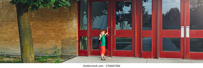 Little happy Caucasian boy student with backpack waving hand farewell. Kid opening door on 1 September day. Education back to school. Child ready to learn, study. Web banner header for website.