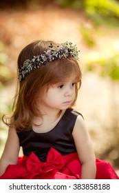 Little happy girl in black-red dress