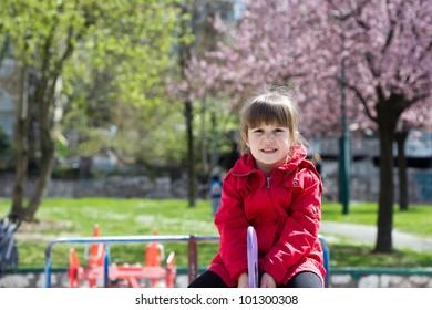 little happy girl in green summer park