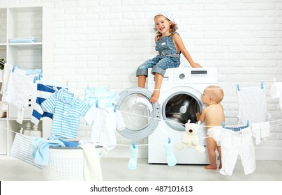 little helpers funny kids happy sister and brother in the laundry to wash clothes, playing and laughing