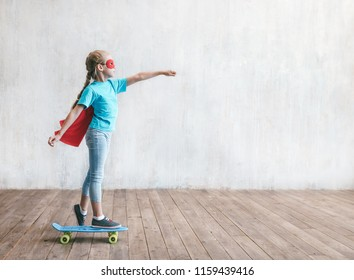 A little hero skating in the studio