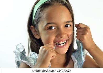 Little Hispanic Girl Flossing