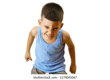 Little hispanic kid in an aggressive posture isolated on white