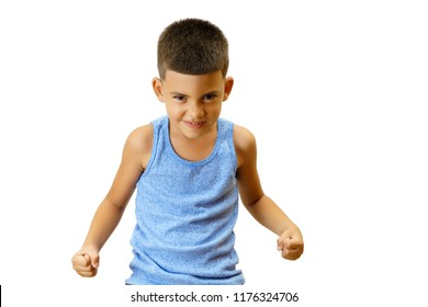 Little hispanic kid in a challenge posture isolated on white