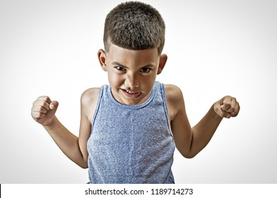 Little hispanic kid in a challenge posture isolated on white.
