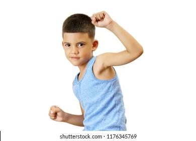 Little hispanic kid training martial arts isolated on white.