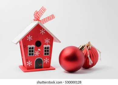 A little house and christmas tree balls