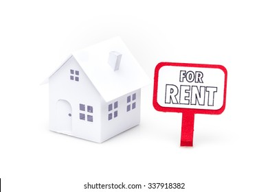 Little house made of paper isolated on white background with a sign for rent.