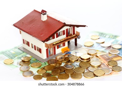little house model with cash euro money