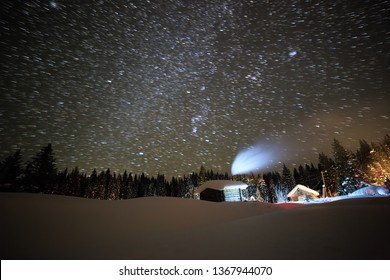 Little House on the background of the starry sky in winter. Leave traces in the form of lines
