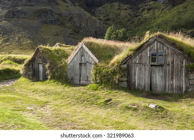 little houses with grass on roof in Iceland
