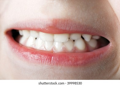 Little human baby child teeth mouth on face macro