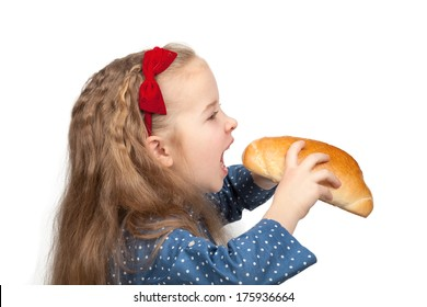 Little hungry girl biting a bun isolated on white background