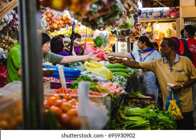 Little India, Singapore - December 25, 2015: People buying fruits and vegetables at one of the stalls at the Tekka Centre in Little India, Singapore.