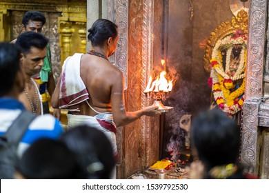 Little India, Singapore - October 18, 2019 : People praying at Hindu temple Sri Veeramakaliamman to celebrate Hindu Indian Diwali (Deepavali) festival.