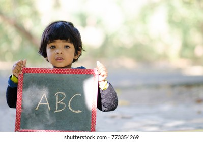 Little Indian child learning ABC alphabets