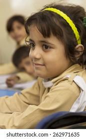 Little Indian girl in class