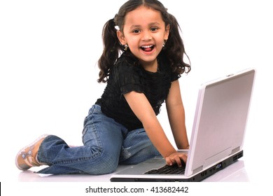 Little Indian girl with laptop