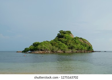 A little island in the middle of the sea, not far from the shore like a dream island in front