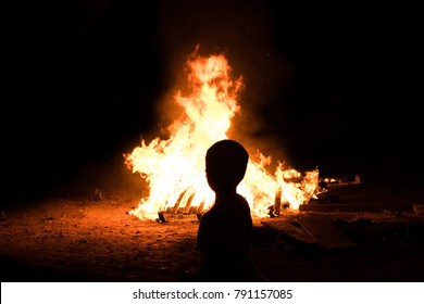 Little jewish boy near to bonfires at Jewish holiday of Lag Baomer, the day of commemorate the death of Rabbi Shimon Bar Yochai