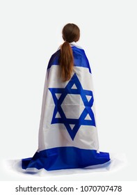 The little Jewish girl is looking at the viewer, and wrapped his shoulders a large flag of Israel