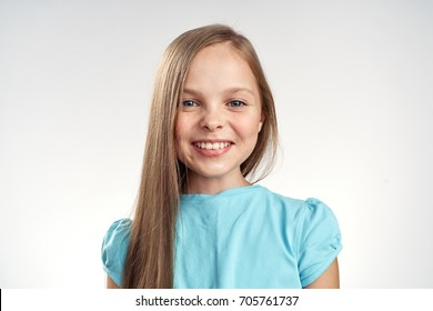 Little joyful girl smiling on a light background portrait