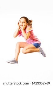 Little jumping caucasian girl isolated on white background