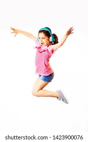 Little jumping and shouting little caucasian girl with a headphones on white background