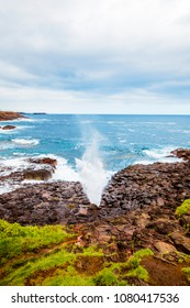 Little Kiama Blowhole. Water can be seen coming out of the blowhole when a wave strikes the coast.