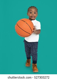 Little Kid With Basketball Concept