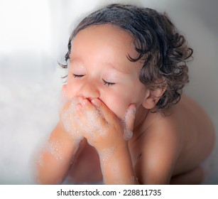 little kid in the bath tub