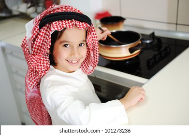 Little kid boy is cooking