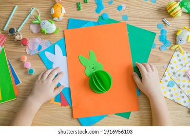 Little kid boy holding Bunny  for Easter greetings card. Children's art project. DIY concept
