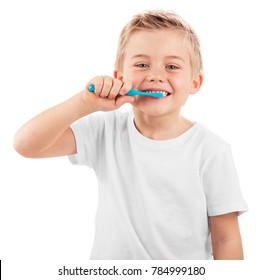 LITTLE KID BRUSHING HIS TEETH SMILING HAPPY ISOLATED ON WHITE BACKGROUND, DENTAL HYGIENE OF LITTLE BOY, MEDICAL CARE