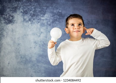 Little kid with a bulb light in his hands. dea concept