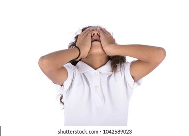 A little kid covering his face with his hands and looking up screaming, isolated on a white background.