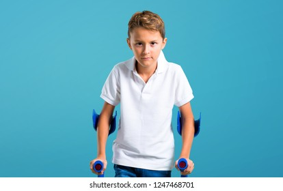 Little kid with crutches on color baackground