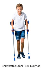 Little kid with crutches on isolated white background