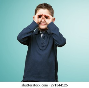 little kid doing a glasses gesture