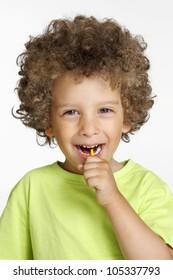 Little kid eating a lollipop portrait.