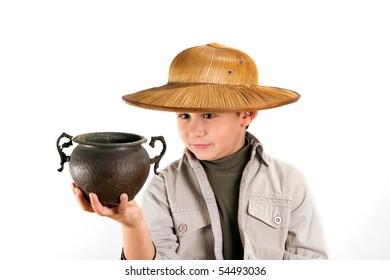 little kid explorer examining bronze age pot