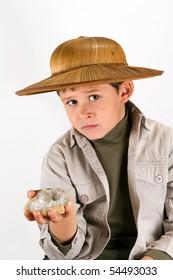 little kid explorer examining large Cristal / precious gem