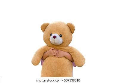 The little kid hand hug the teddy bear